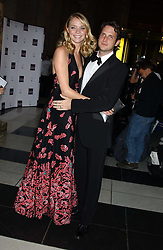 Model JODIE KIDD and her husband AIDEN BUTLER at the 2005 British Fashion Awards were held at The V&A museum, London on 10th November 2005.<br />