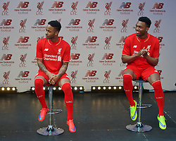 LIVERPOOL, ENGLAND - Friday, April 10, 2015: Liverpool's Raheem Sterling and Daniel Sturridge during the launch for the New Balance 2015/16 home kit at Anfield. (Pic by David Rawcliffe/Propaganda)