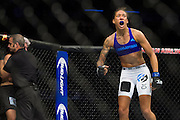 DALLAS, TX - MARCH 14:  Germaine de Randamie celebrates after defeating Larissa Pacheco during UFC 185 at the American Airlines Center on March 14, 2015 in Dallas, Texas. (Photo by Cooper Neill/Zuffa LLC/Zuffa LLC via Getty Images) *** Local Caption *** Germaine de Randamie; Larissa Pacheco