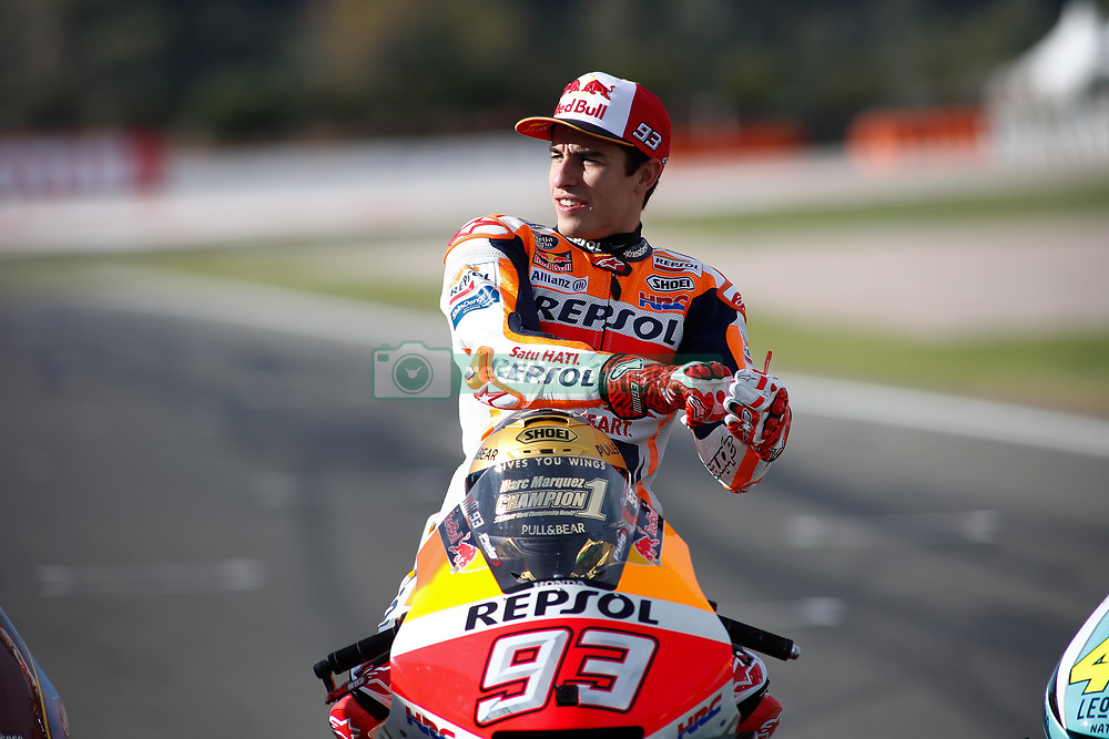 November 17, 2019, Cheste, VALENCIA, SPAIN: Marc Marquez, rider of Repsol Honda Team from Spain, put his gloves attends during the World Champion photo during the Valencia Grand Prix of MotoGP World Championship celebrated at Circuit Ricardo Tormo on November 16, 2019, in Cheste, Spain. (Credit Image: © AFP7 via ZUMA Wire)