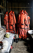 Pil'tun Lighhouse, Sakhalin..Water temperatures in the Sea of Ohotsk are just a few degrees above freezing. Survival suits are a necessity for the scientists when working on the raft.