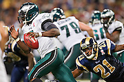 ST. LOUIS, MO - SEPTEMBER 11:   Michael Vick #7 of the Philadelphia Eagles tries to get away from Justin King #21 of the St. Louis Rams at the Edward Jones Dome on September 11, 2011 in St. Louis, Missouri.  The Eagles defeated the Rams 31 to 13.  (Photo by Wesley Hitt/Getty Images) *** Local Caption *** Michael Vick; Justin King