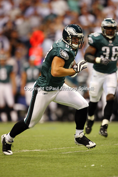 IRVING, TX - SEPTEMBER 15:  Tight end Brent Celek #87 of the Philadelphia Eagles runs with the ball after catching a third down pass good for a first down to the Dallas Cowboys 23 yard line on the Eagles opening drive at Texas Stadium on September 15, 2008 in Irving, Texas. The Cowboys defeated the Eagles 41-37. ©Paul Anthony Spinelli *** Local Caption *** Brent Celek