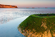 At the beach of Arromanches-les-Bains one can still see what remains of the artificial mulberry harbours that were used by the allies to disembark tanks and trucks during World War II