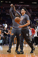 PHOENIX, AZ - APRIL 13:  Devin Booker (1) and Archie Goodwin (20) of the Phoenix Suns warm up wearing their Nike sneakers prior to the game against the Los Angeles Clippers at Talking Stick Resort Arena on April 13, 2016 in Phoenix, Arizona.  NOTE TO USER: User expressly acknowledges and agrees that, by downloading and or using this photograph, User is consenting to the terms and conditions of the Getty Images License Agreement. (Photo by Jennifer Stewart/Getty Images)