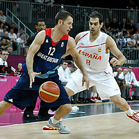 02 August 2012: Spain Jose Calderon defends on Great Britain Nate Reinking during 79-78 Team Spain victory over Team Great Britain, during the men's basketball preliminary, at the Basketball Arena, in London, Great Britain.