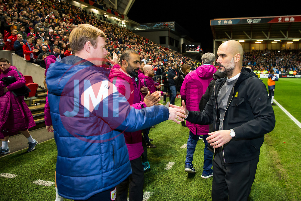 Bristol City Assistant Head Coach Dean Holden congratulates Manchester City manager Pep Guardiola after Manchester City win 2-3 - Rogan/JMP - 23/01/2018 - Ashton Gate Stadium - Bristol, England - Bristol City v Manchester City - Carabao Cup Semi Final Second Leg.