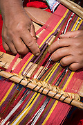 Weaving traditional Quechua cloth in Misminay Village, Sacred Valley, Peru.