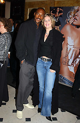 Actor COLIN SALMON and FIONA HAWTHORNE at a party to celebrate Pamela Anderson's new role as spokesperson and newest face of the MAC Aids Fund's Viva Glam V Campaign held at Home House, Portman Square, London on 21st April 2005.<br />