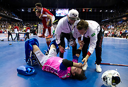 BERLIN - Indoor Hockey World Cup<br /> Final: Germany - Austria<br /> Austria wins the world championship.<br /> foto: Tobias Walter defeated while Austria celebrates.<br /> WORLDSPORTPICS COPYRIGHT FRANK UIJLENBROEK