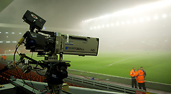 LIVERPOOL, ENGLAND - Monday, February 6, 2012: A television camera at Liverpool's Anfield Stadium shrouded in fog rolling in off the River Mersey before the Premiership match against Tottenham Hotspur at Anfield. (Pic by David Rawcliffe/Propaganda)