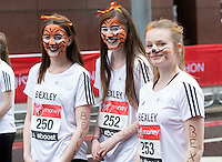 Competitors wait at the start of the U17 girls race. The Virgin Money London Marathon, Sunday 26th April 2015.<br /> <br /> Photo: Jed Leicester for Virgin Money London Marathon<br /> <br /> For more information please contact Penny Dain at pennyd@london-marathon.co.uk