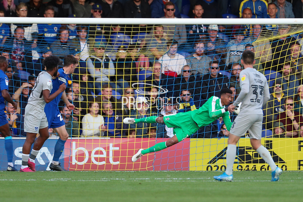 AFC Wimbledon goalkeeper Nathan Trott (1) making double handed save during the EFL Sky Bet League 1 match between AFC Wimbledon and Portsmouth at the Cherry Red Records Stadium, Kingston, England on 19 October 2019.