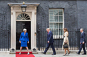 UNITED KINGDOM, London: 04 June 2019 <br /> The British Prime Minister Theresa May (left) walks President Donald Trump and his wife Melania and Theresa May's husband Philip (far right) up to No 10 Downing Street to welcome them during The President's official state visit.