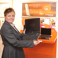 """Shani Roberts, Meteor Store Manager, O'Connell Street, Ennis demonstrates Meteor's mobile broadband offering """"Broadband to Go"""" at its launch in the Ennis Store. Ennis joins 67 other towns and five major urban areas on Meteor's 3G high speed data network. Photograph by: Mike O'Flanagan/O'Flanagan Photography"""