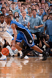 CHAPEL HILL, NC - MARCH 05: Nolan Smith #2 of the Duke Blue Devils dribbles the ball while playing the North Carolina Tar Heels on March 05, 2011 at the Dean E. Smith Center in Chapel Hill, North Carolina. North Carolina won 67-81. (Photo by Peyton Williams/UNC/Getty Images) *** Local Caption *** Nolan Smith