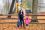 Carrie Gross stands with her three children in front of a horizontal directional drill site near her home in Chester County, PA. November 18, 2017.