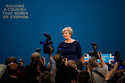 "© Licensed to London News Pictures. 04/10/2017. Manchester, UK. The letters F and E fallen off the conservative party slogan  ""BUILDING A COUNTRY THAT WORKS FOR EVERYONE"" at the and of the speech.  British prime minister THERESA MAY delivers her leaders speech on the final day of the Conservative Party Conference. The four day event is expected to focus heavily on Brexit, with the British prime minister hoping to dampen rumours of a leadership challenge. Photo credit: Ben Cawthra/LNP"