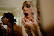"""Sex worker Savanna Rae checks her makeup at the Moonlite Bunny Ranch brothel in Mound House, NV on Friday, July 28, 2006...The Moonlite Bunny Ranch brothel in Mound House, Nevada - just a few miles from the state capital in Carson City - first opened in 1955. The Ranch is a legal, licensed brothel owned by Dennis Hof. It's featured in the HBO series """"Cathouse."""""""