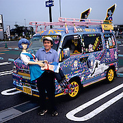 Nidaira Yasuhiko, 42, is an electrician from Ibaraki Prefecture. He lives with his family, and on free days likes to take the two-hour drive with his mother and younger sister to Akihabara – in a blue box van decorated in tribute of his favorite character, Ayanami Rei from Neon Genesis Evangelion. The outside has dozens of images of her, the interior is filled with character merchandise and there is a life-sized Rei doll in the passenger seat. Nidaira says he is happiest among his hot-rodding otaku friends. He avoids eye contact and is soft spoken; he does not speak unless spoken to and answers with the minimum required information.