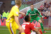 Nottingham Forest goalkeeper Dorus de Vries tracks the ball during the Sky Bet Championship match between Nottingham Forest and Milton Keynes Dons at the City Ground, Nottingham, England on 19 December 2015. Photo by Aaron Lupton.