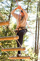 Kevin Donlon makes his way through the course during the Wounded Warrior group outing in the Aerial Treetop Adventure at Gunstock on Monday afternoon.  (Karen Bobotas/for the Laconia Daily Sun)