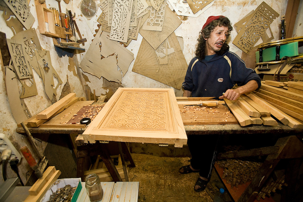 A carpenter in his workshop in the narrow streets of the Imperial city of Meknes, one of Morrocco's three most important historical cities.