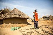 Michael Adeep Makuer, an UNMAS Deminer, is pictured standing by in case of an emergency, while clearance operations are conducted. UNMAS began clearance of Jebel Kujur, outside of Juba, South Sudan, in January 2017 to ensure the safety of returnees and to enable them to rebuild their lives following the intense fighting in Juba in July 2016, which littered the area with explosive remnants of war. Children searching for scrap metal, a source of income, found unexploded ordnance such as rocket propelled grenades, 80mm recoilless projectiles, and small arms ammunition, which they reported to security at the local UNMISS base. UNMAS conducted surface clearance due to the amount of scrap, which would have interfered with detectors.<br />