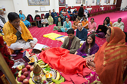 Image ©Licensed to i-Images Picture Agency. 07/03/2015. London, United Kingdom. Ravi Bhanot and family, Conservative Party supporters in Ilford. Ravi and his wife worship together at the local Hindu temple in Ilford. Picture by Daniel Leal-Olivas / i-Images