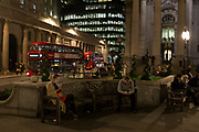 Londoners enjoy a moment of solitude amid the bustle of Cornhill, in the Square Mile, the heart of the capital's historical financial district, on 2nd October 2017, in the City of London, England.
