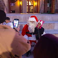 Alayna Penunuri, 7, posing for a photo with Santa at the McKinley County Courthouse Square in Gallup, Saturday Nov. 24 before the tree lighting ceremony.