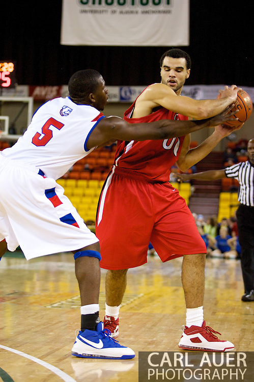 November 27, 2008: Seattle University forward Mike Boxley (00) looks for a pass past Louisiana Tech's Olu Ashaolu (5) in the opening round of the 2008 Great Alaska Shootout at the Sullivan Arena