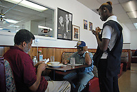 USA, Chicago, IL, June 28- July 5, 2011. A Chicago soul food landmark for over 40 years, Edna's Restaurant in West Garfield Park had both a loyal customer base and a staff to match, weathering a temporary closure in 2010 after the death of its founder. Now called Ruby's Restaurant, new owner Henry Henderson and long-time manager Lillie Joiner debate their choices in trying to find health-care coverage for their employees. The  Affordable Care Act already provides many such establishments with tax credits for health care coverage, and by 2014, a new marketplace will ensure Illinois small businesses have quality, affordable coverage options.