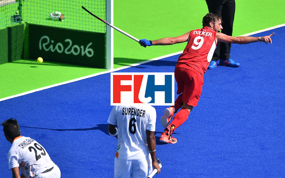 Belgium's Sebastien Dockier (R) celebrates a goal during the men's quarterfinal field hockey Belgium vs India match of the Rio 2016 Olympics Games at the Olympic Hockey Centre in Rio de Janeiro on August 14, 2016. / AFP / Carl DE SOUZA        (Photo credit should read CARL DE SOUZA/AFP/Getty Images)