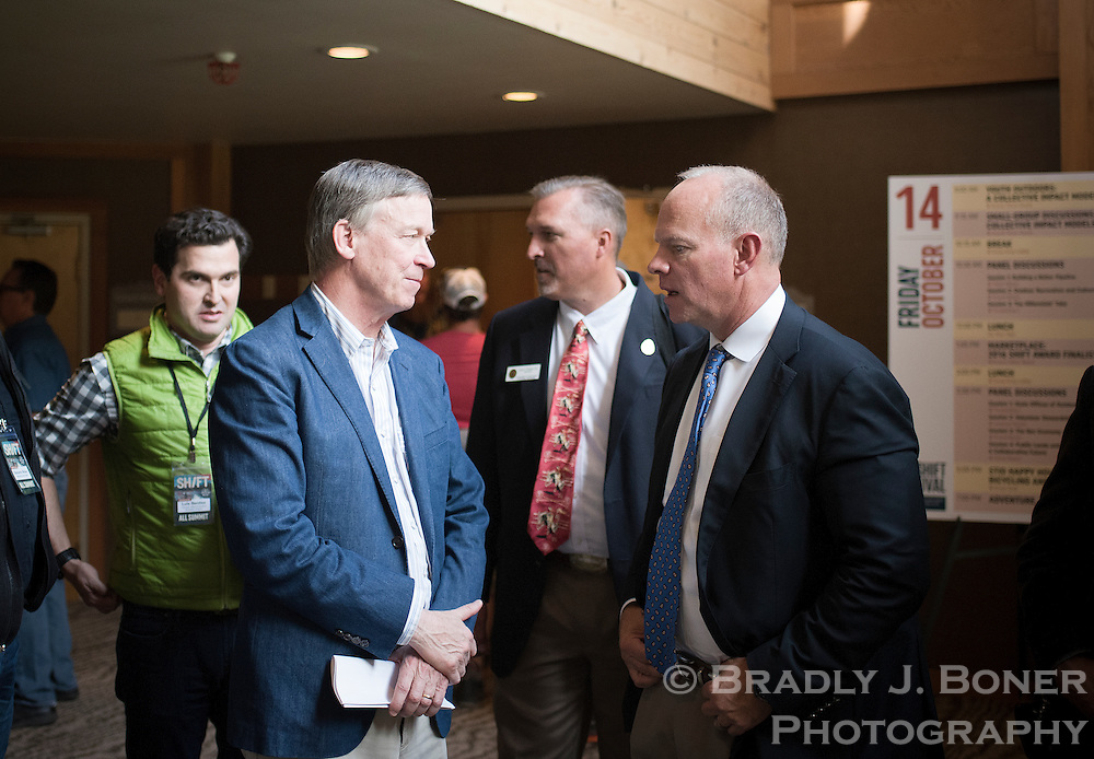 Wyoming Gov. Matt Mead, right, visits with Colorado Gov. John Hickenlooper after speaking at the opening day of the SHIFT summit Thursday at Snow King Resort. The third-annual festival, which brings together recreationalists, land managers and conservation advocates to find ways to advocate for the protection of public lands, continues today through Saturday.