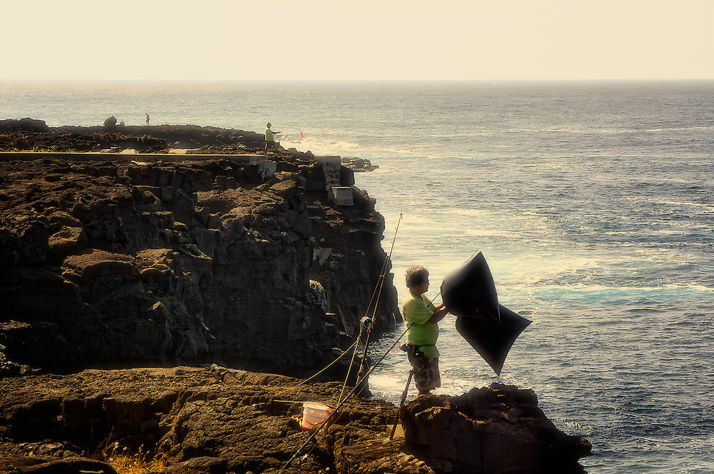 Fishermen cast off a cliff in Ka Lae, Hawaii, the southern-most tip of the USA.