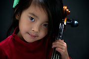 Four year old Amelie with her cello at home before formal practice at Levine School of Music in Northwest Washington, DC..