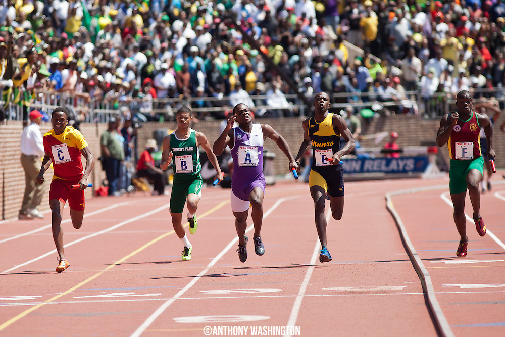 Tevin-Lloyd Thompson of Kingston College (Jamaica) leads the field during the High School Boys' 4x100 Championship of America at the 119th Penn Relays on Saturday, April 27, 2013 in Philadelphia, PA.