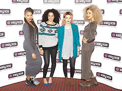 © Licensed to London News Pictures . 08/11/2013 . Manchester , UK . NEON JUNGLE . Stars in front of the Key 103 brand board at Manchester Town Hall ahead of performing on stage . The Christmas lights are turned on in Manchester this evening (Friday 8th November 2013) . Photo credit : Joel Goodman/LNP