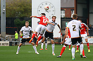 Crewe Alexandra&rsquo;s Billy Waters and Vale&rsquo;s Chris Lines jump for the ball. Skybet football league one match, Crewe Alexandra v Port Vale at the Alexandra Stadium in Crewe on Saturday 13th Sept 2014.<br /> pic by Chris Stading, Andrew Orchard sports photography.