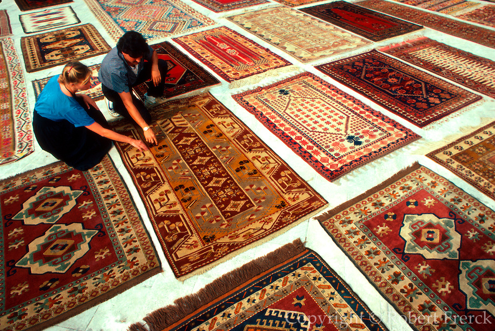 TURKEY, ISTANBUL Anatolian carpets displayed for buyers in the plaza below the Sultan Ahmet Camii also called the Blue Mosque