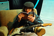 The Red Hot Chili Peppers John Frusciante reads his new album book behind the scenes waiting at MTV studios in Times Square for their appearance of TRL in Manhattan, NY. They have released a new album. 5/9/2006 Photo by Jennifer S. Altman