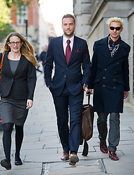 © London News Pictures. 13/11/2013. London, UK. CALUM BEST (centre) arriving at The Old Bailey in London where former editors of the News Of The World are facing trial over allegations of  phone hacking and and payments to officials at News International. Photo credit: Ben Cawthra/LNP