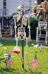 30 October 2015. New Orleans, Louisiana.<br /> The Skeleton Krewe mansion on St Charles Avenue at the corner of State Street draws crowds with its satirically spooky Halloween decorations. American politics comes under fire with skeletons depicting Presidential hopeful Bernie Sanders is depicted as Burn-Knee.<br /> Photo©; Charlie Varley/varleypix.com