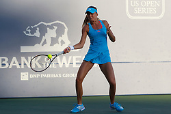 July 27, 2011; Stanford, CA, USA;  Daniela Hantuchova (SVK) returns the ball against Maria Sharapova (RUS), not pictured, during the second round of the Bank of the West Classic women's tennis tournament at the Taube Family Tennis Stadium.