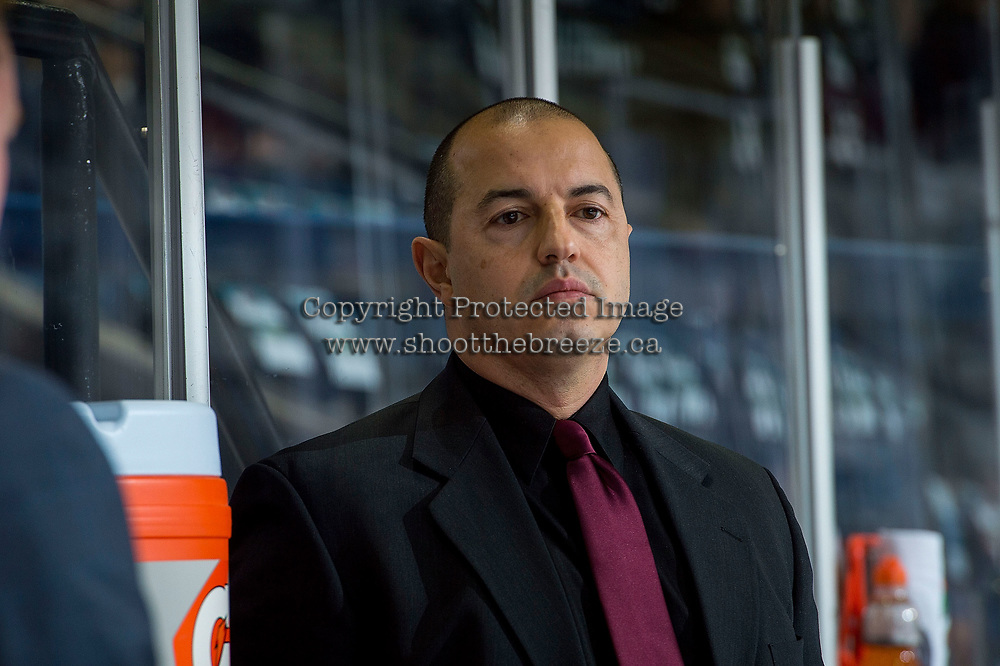 KELOWNA, CANADA - DECEMBER 27: Kamloops Blazers' goaltending coach Dan De Palma stands on the bench during warm up against the Kelowna Rockets on December 27, 2017 at Prospera Place in Kelowna, British Columbia, Canada.  (Photo by Marissa Baecker/Shoot the Breeze)  *** Local Caption ***
