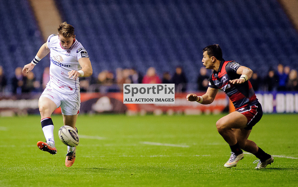 16/10/2015, Murrayfield, Scotland, Craig Gilroy chips the ball down the line as Damien Hoyland closes in during the Edinburgh Rugby v Ulster Guinness PRO12 game, ......(c) COLIN LUNN | SportPix.org.uk