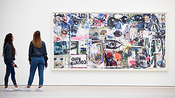 """© Licensed to London News Pictures. 27/09/2018. LONDON, UK  Staff members view """"Country Road"""", 2010, by Douglas Kolk.  Preview of """"Black Mirror"""", a major new exhibition featuring the work of 26 contemporary artists, at the Saatchi Gallery.  The show explores art's role in social satire and how political uncertainty has influenced art of recent years and runs 28 September to 13 January 2019.   Photo credit: Stephen Chung/LNP"""