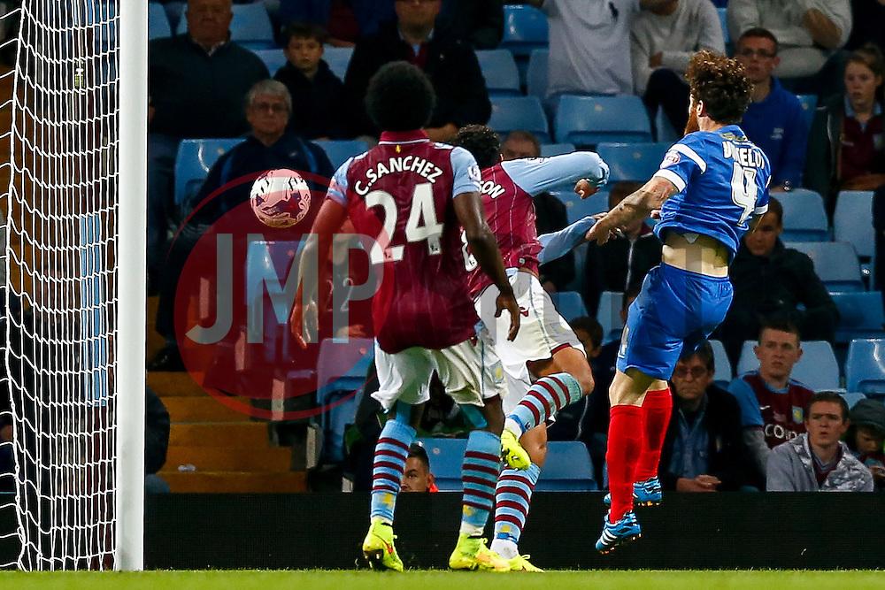 Romain Vincelot of Leyton Orient scores sending a shot Kieran Richardson and goalkeeper Shay Given of Aston Villa - Photo mandatory by-line: Rogan Thomson/JMP - 07966 386802 - 27/08/2014 - SPORT - FOOTBALL - Villa Park, Birmingham - Aston Villa v Leyton Orient - Capital One Cup Round 2.