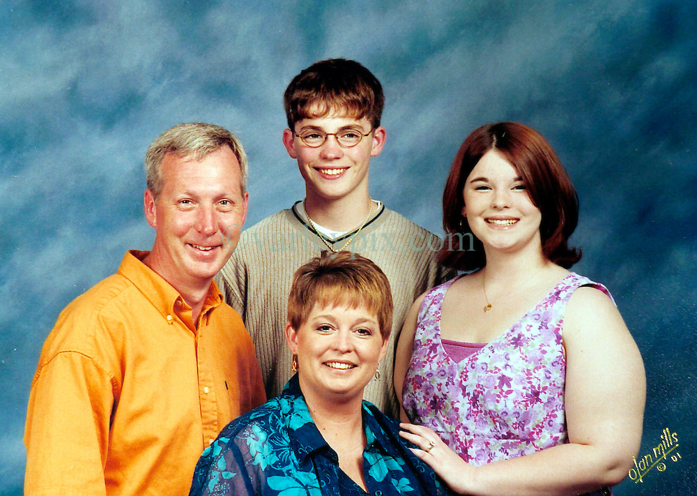 21 May 2015. Laurel, Mississippi.<br /> Collect photos of plus size model Tess Holliday (formerly known as Tess Munster, née Ryann Hoven) in her formative years from a family album.  Tass (rt) in a family portrait with 1st stepfather Joey Wislon (l), brother Tad Hoven and mother Beth.<br /> Photo credit; Tadlock via Varleypix.com